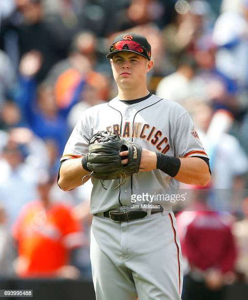 Christian Arroyo of the San Francisco Giants looks on between innings of a game against the New York Mets at Citi Field on May 10 2017 in the...