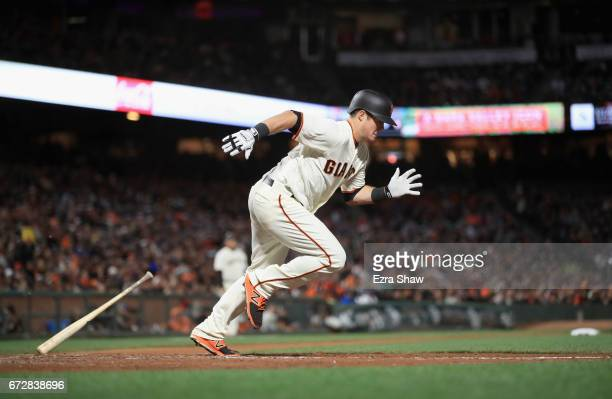 Christian Arroyo of the San Francisco Giants runs to first base against the Los Angeles Dodgers at ATT Park on April 24 2017 in San Francisco...