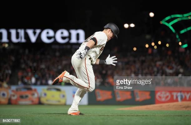 Christian Arroyo of the San Francisco Giants runs to first base against the San Francisco Giants at ATT Park on April 24 2017 in San Francisco...
