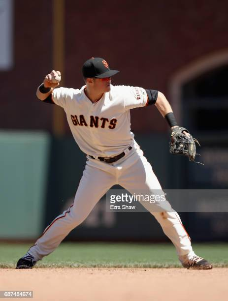 Christian Arroyo of the San Francisco Giants throws to first base during their game against the Los Angeles Dodgers at ATT Park on May 17 2017 in San...