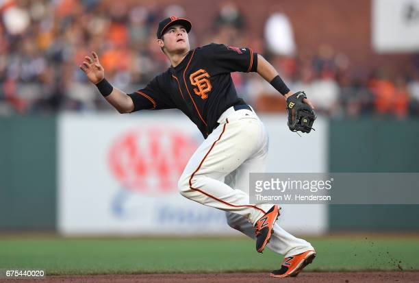 Christian Arroyo of the San Francisco Giants tracks a fly ball against the San Diego Padres at ATT Park on April 29 2017 in San Francisco California