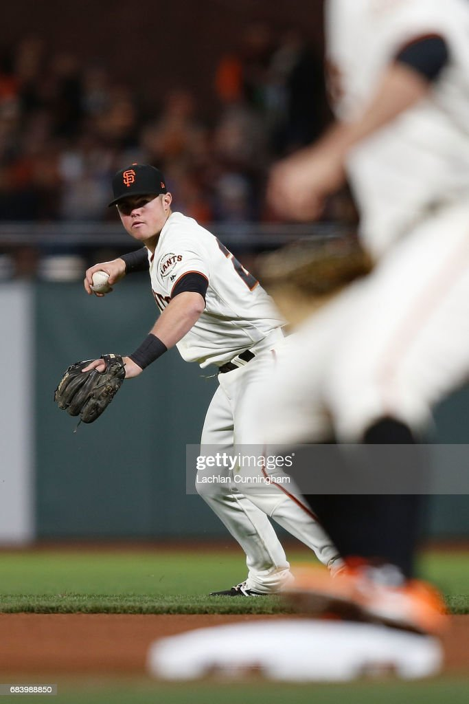 Christian Arroyo #22 of the San Fransisco Giants fields a ground ball hit by Joc Pederson #31 of the Los Angeles Dodgers in the seventh inning at AT&T Park on May 16, 2017 in San Francisco, California.