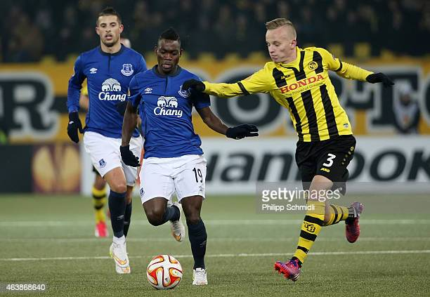 Christian Atsu of Everton FC fights for the ball with Florent Hadergjonaj of BSC Young Boys during the UEFA Europa League Round of 32 match between...