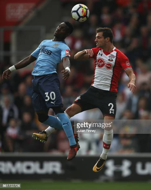 Christian Atsu of Newcastle goes for a header with Cedric of Southampton during the Premier League match between Southampton and Newcastle United at...