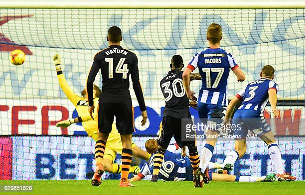 Christian Atsu of Newcastle Unitd scores the second goa to make the score 02 during the Sky Bet Championship match between Wigan Athletic and...