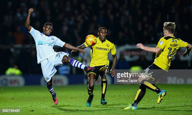 Christian Atsu of Newcastle United beats Lloyd Dyer of Burton Albion and Damien McCrory of Burton Albion to the ball during the Sky Bet Championship...