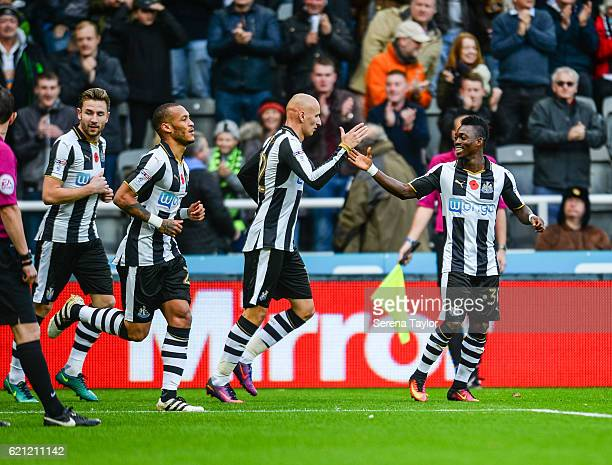 Christian Atsu of Newcastle United celebrates with teammate Jonjo Shelvey after scoring their opening goal during the Sky Bet Championship match...