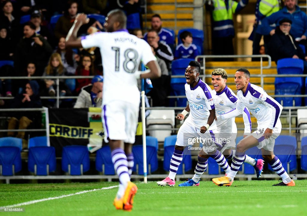 Christian Atsu of Newcastle United (30) celebrates with teammates after he scores the opening goal from a free kick during the Sky Bet Championship match between Cardiff City and Newcastle United at the Cardiff City Stadium on April 28, 2017 in Cardiff, Wales.