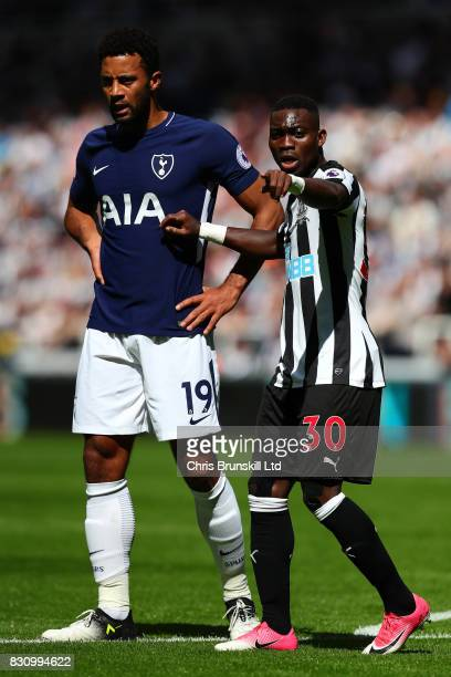 Christian Atsu of Newcastle United competes with Mousa Dembele of Tottenham Hotspur during the Premier League match between Newcastle United and...