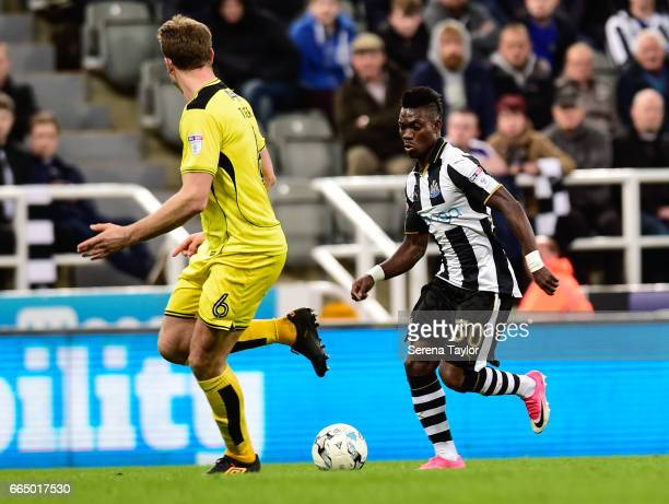 Christian Atsu of Newcastle United runs with the ball during the Sky Bet Championship Match between Newcastle United and Burton Albion at StJames'...