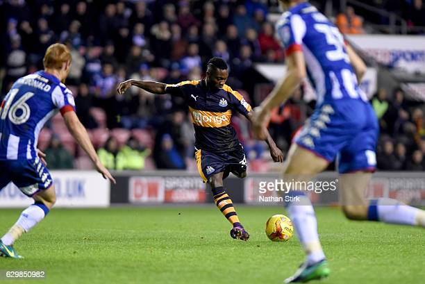 Christian Atsu of Newcastle United scores the second goal during the Sky Bet Championship match between Wigan Athletic and Newcastle United at DW...