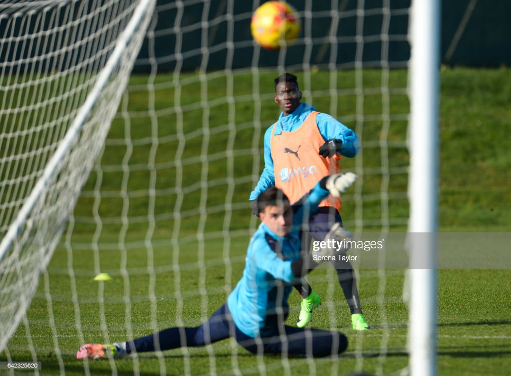 Christian Atsu strikes the ball past Goalkeeper Karl Darlow during the Newcastle United Training Session at The Newcastle United Training Centre on February 17, 2017 in Newcastle upon Tyne, England.