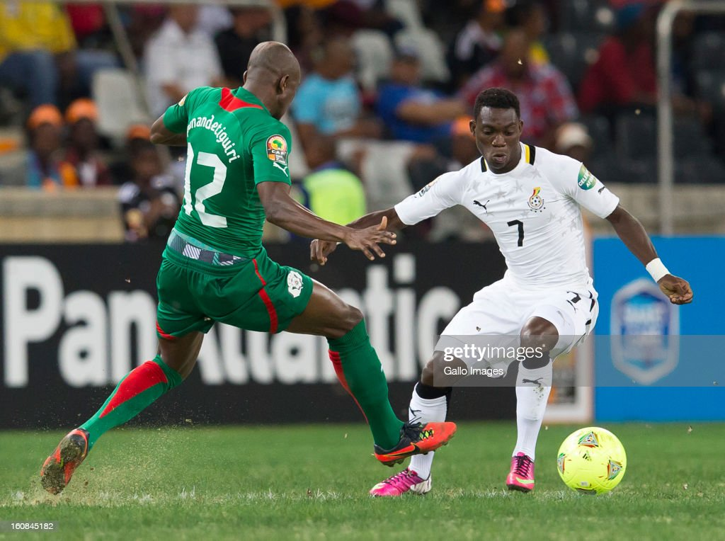 Christian Atsu Twasam from Ghana and Saidou Mady Panandetiguiri from Burkina Faso compete for the ball during the 2013 Orange African Cup of Nations 2nd Semi Final match between Burkina Faso and Ghana at Mbombela Stadium on February 06, 2013 in Nelspruit, South Africa.