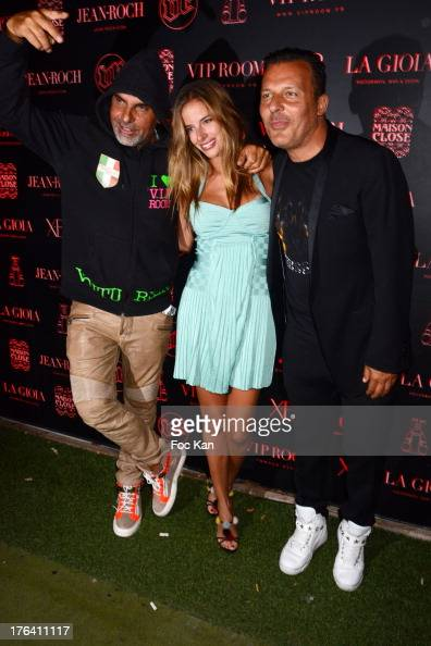 Christian Audigier his Nathalie Sorensen and Jean Roch Pedri attend the Cut Killer DJ set during the VIP Room Party in Saint Tropez on August 7 2013...