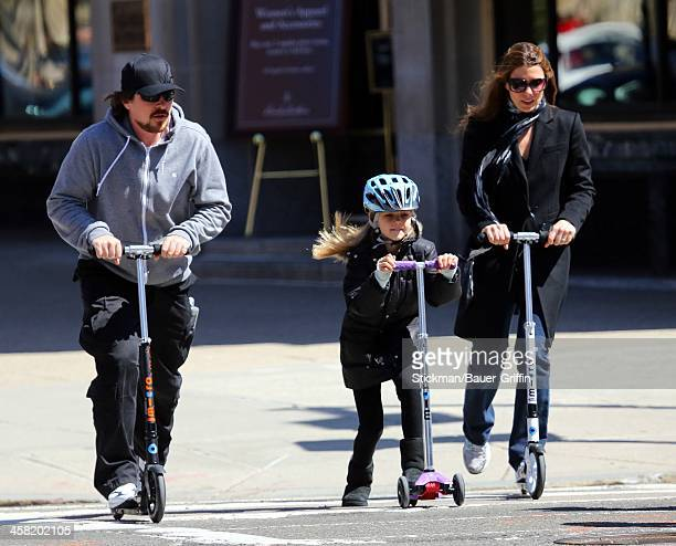 Christian Bale and Sandra Blazic with daughter Emmeline Bale are seen on April 06 2013 in Boston Massachusetts