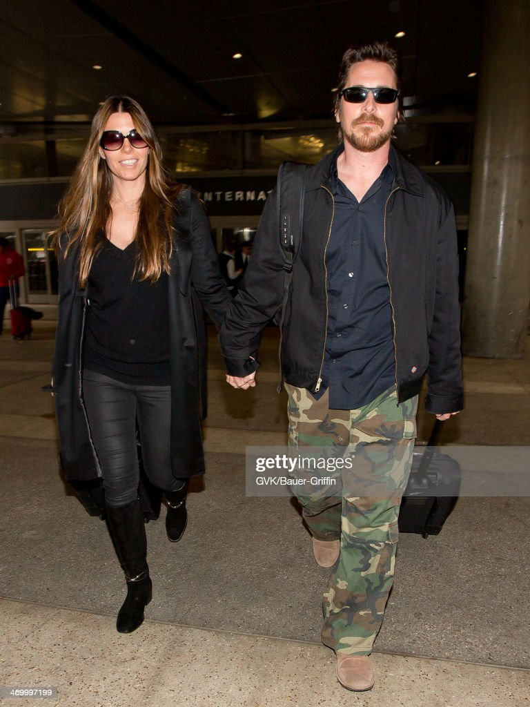 <a gi-track='captionPersonalityLinkClicked' href=/galleries/search?phrase=Christian+Bale&family=editorial&specificpeople=239518 ng-click='$event.stopPropagation()'>Christian Bale</a> and Sibi Blazic are seen at LAX airport on February 17, 2014 in Los Angeles, California.