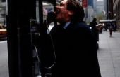 Christian Bale at pay phone in a scene from the film 'American Psycho' 2000