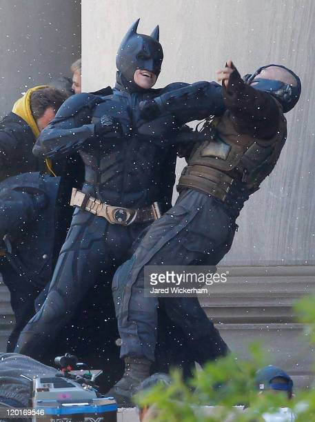 Christian Bale playing Batman acts in a scene with Tom Hardy playing Bane during the filming of the new Batman Dark Knight Rises movie at the Mellon...