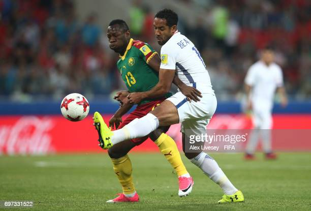 Christian Bassogog of Cameroon and Jean Beausejour of Chile battle for possession during the FIFA Confederations Cup Russia 2017 Group B match...