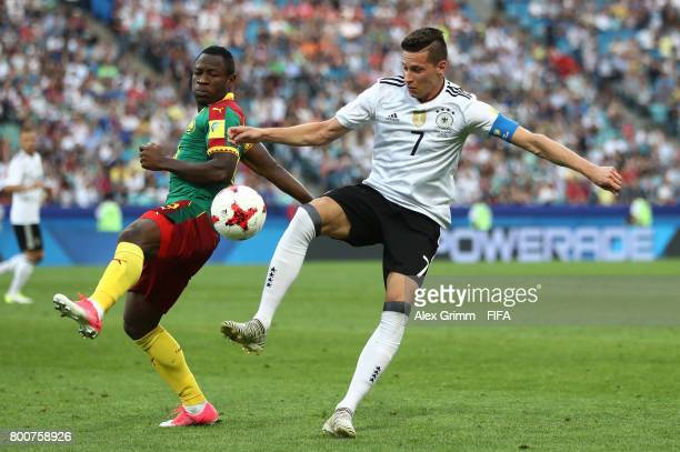 Christian Bassogog of Cameroon and Julian Draxler of Germany battle for possession during the FIFA Confederations Cup Russia 2017 Group B match...