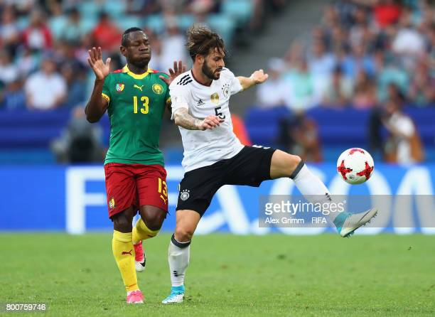 Christian Bassogog of Cameroon puts pressure on Marvin Plattenhardt of Germany during the FIFA Confederations Cup Russia 2017 Group B match between...