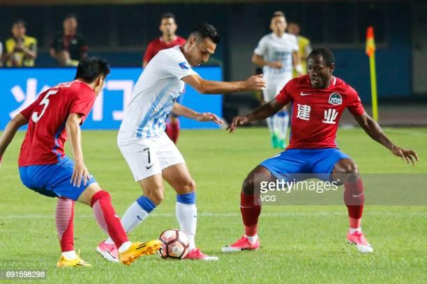 Christian Bassogog of Henan Jianye and Eran Zahavi of Guangzhou RF compete for the ball during the 12th round match of 2017 Chinese Football...