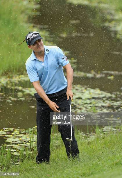 Christian Basson of South Africa plays his third shot out of the water on the fourth hole during the second round of the Tshwane Open at Pretoria...