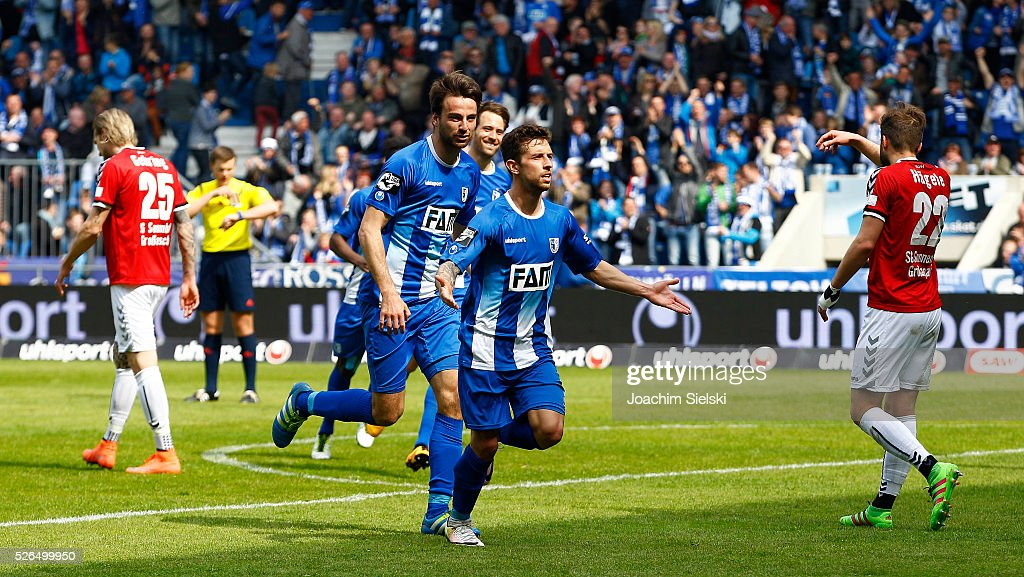 Christian Beck and Goalgetter Manuel Farrona-Pulido of Magdeburg celebration the goal 3:0 for Magdeburg during the Third League match between 1. FC Magdeburg and SG Sonnenhof-Grosssaspach at MDCC-Arena on April 30, 2016 in Magdeburg, Germany.