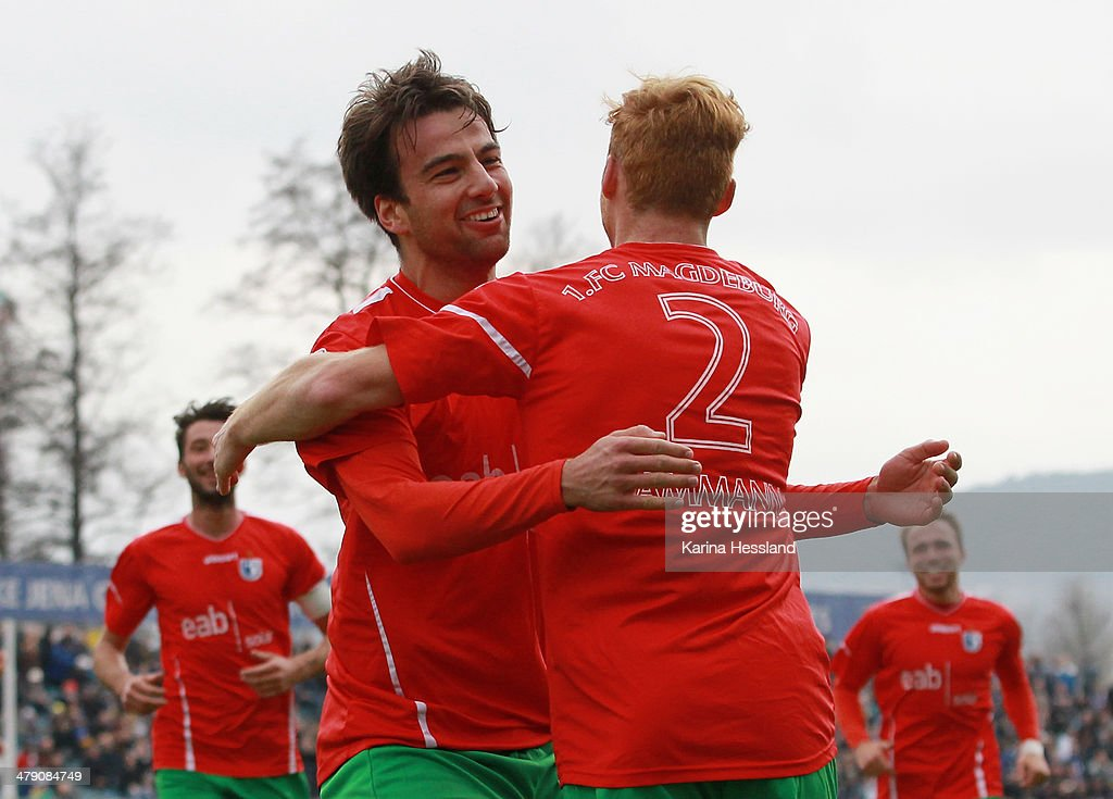Christian Beck celebrates the third goal with Nico Hammann of Magdeburg during the Regionalliga match between FC Carl Zeiss Jena and 1.FC Magdeburg at Ernst Abbe Sportfeld on March 16, 2014 in Jena, Germany.