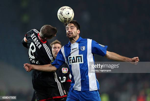 Christian Beck of Magdeburg and Lars Bender of Leverkusen for the ball during the DFB Cup second round match between 1 FC Magdeburg and Werder Bremen...