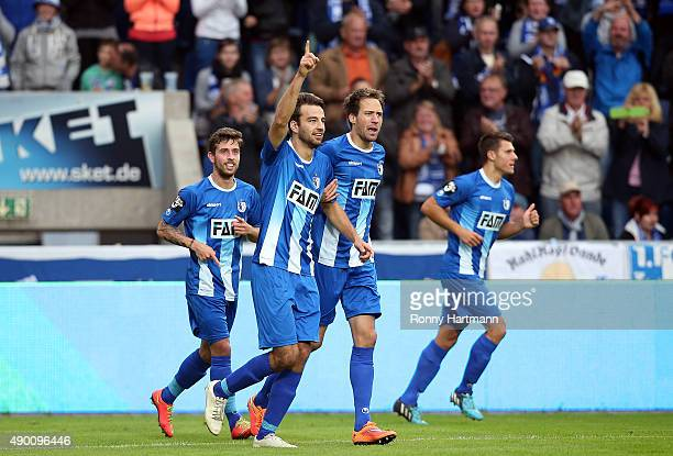 Christian Beck of Magdeburg celebrates after scoring his team's opening goal with Steffen Puttkammer of Magdeburg during the Third League match...