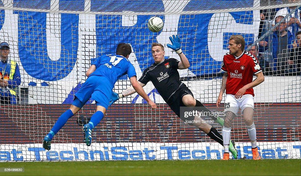 Christian Beck of Magdeburg challenges Christopher Gaeng and Kai Gehring of Sonnenhof-Grossaspach with the goal 2:0 for Magdeburg during the Third League match between 1. FC Magdeburg and SG Sonnenhof-Grosssaspach at MDCC-Arena on April 30, 2016 in Magdeburg, Germany.