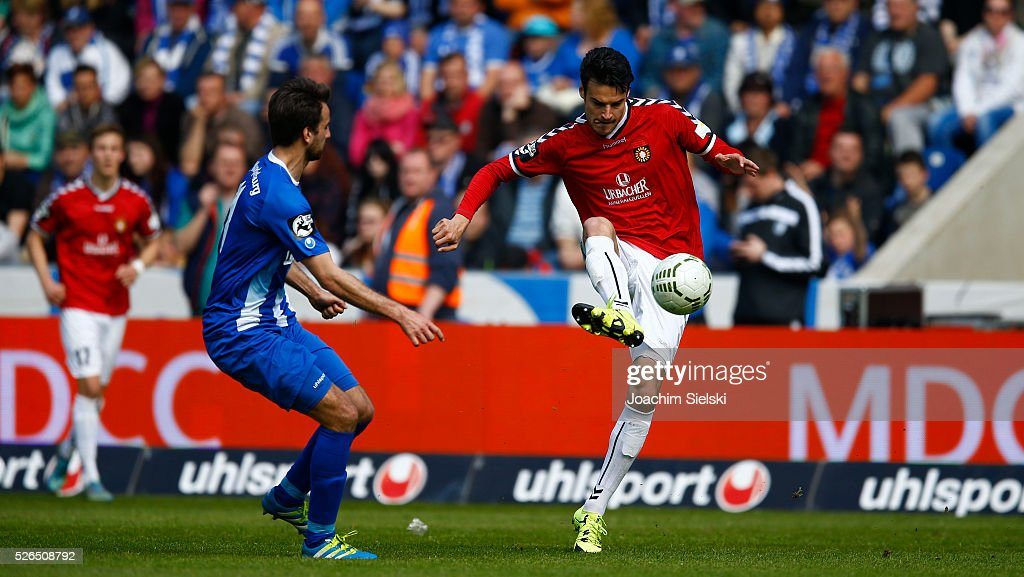 Christian Beck of Magdeburg challenges Julian Leist of Sonnenhof-Grossaspach during the Third League match between 1. FC Magdeburg and SG Sonnenhof-Grosssaspach at MDCC-Arena on April 30, 2016 in Magdeburg, Germany.