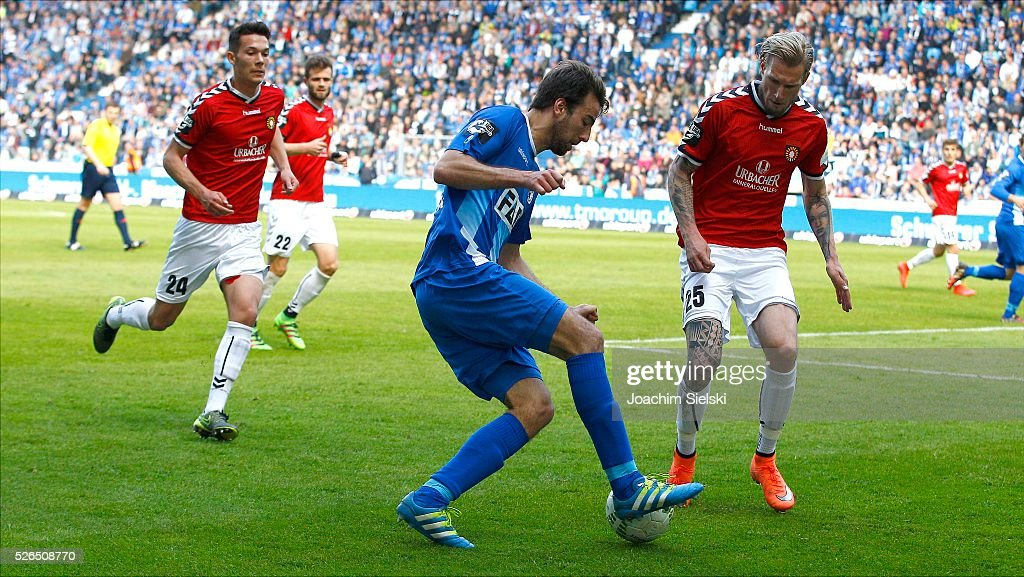 Christian Beck of Magdeburg challenges Kai Gehring of Sonnenhof-Grossaspach during the Third League match between 1. FC Magdeburg and SG Sonnenhof-Grosssaspach at MDCC-Arena on April 30, 2016 in Magdeburg, Germany.