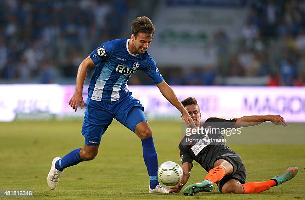 Christian Beck of Magdeburg is attacked by Mario Erb of Erfurt during the Third League match between 1 FC Magdeburg and FC Rot Weiss Erfurt at...