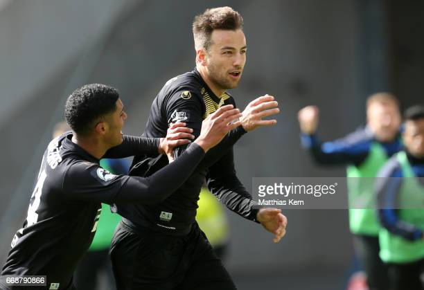 Christian Beck of Magdeburg jubilates with team mate Tarek Chahed after scoring the first goal during the third league match between FC Hansa Rostock...