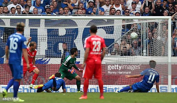 Christian Beck of Magdeburg scores his teams first goal during the Third League match between 1 FC Magdeburg and Hallescher FC at MDCCArena on August...