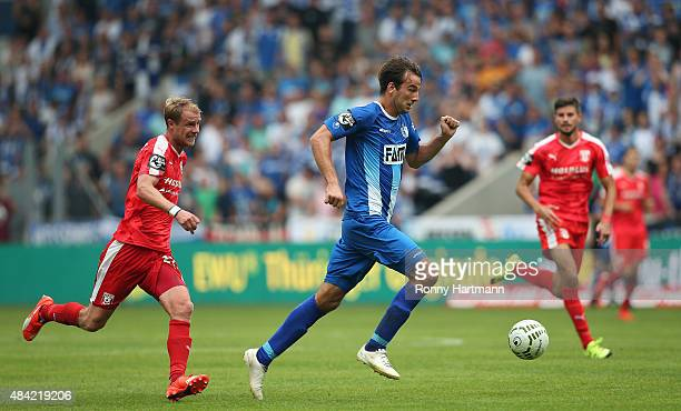 Christian Beck of Magdeburg vies with Marco Engelhardt of Halle during the Third League match between 1 FC Magdeburg and Hallescher FC at MDCCArena...