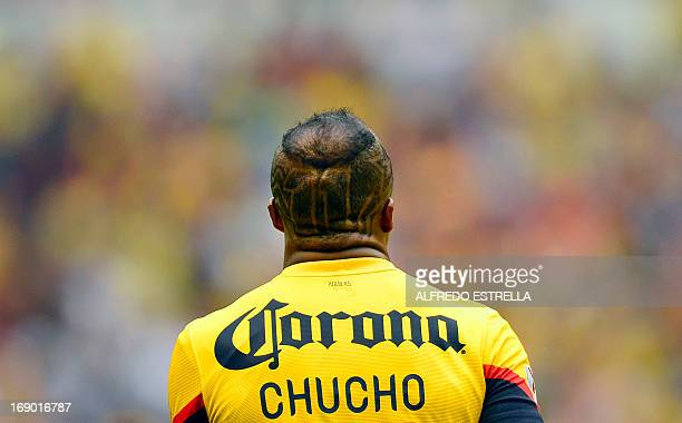 Christian Benitez of America celebrates his goal against Monterrey during their Mexican Clausura Tournament semifinal football match on May 18 2013...