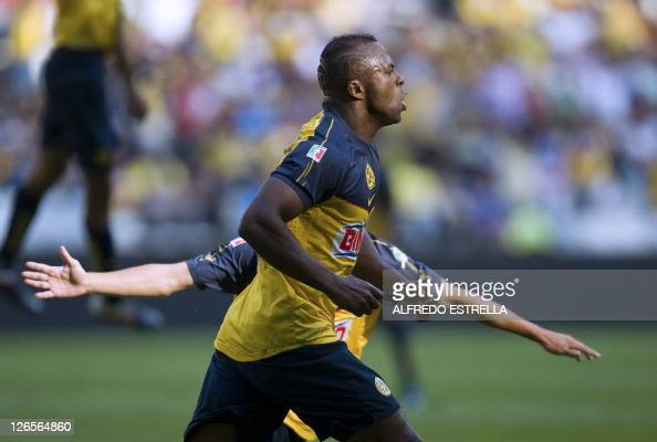 Christian Benitez of America celebrates his goal against Xolos from Tijuana during their Mexican Apertura 2011 tournament football match in Mexico...