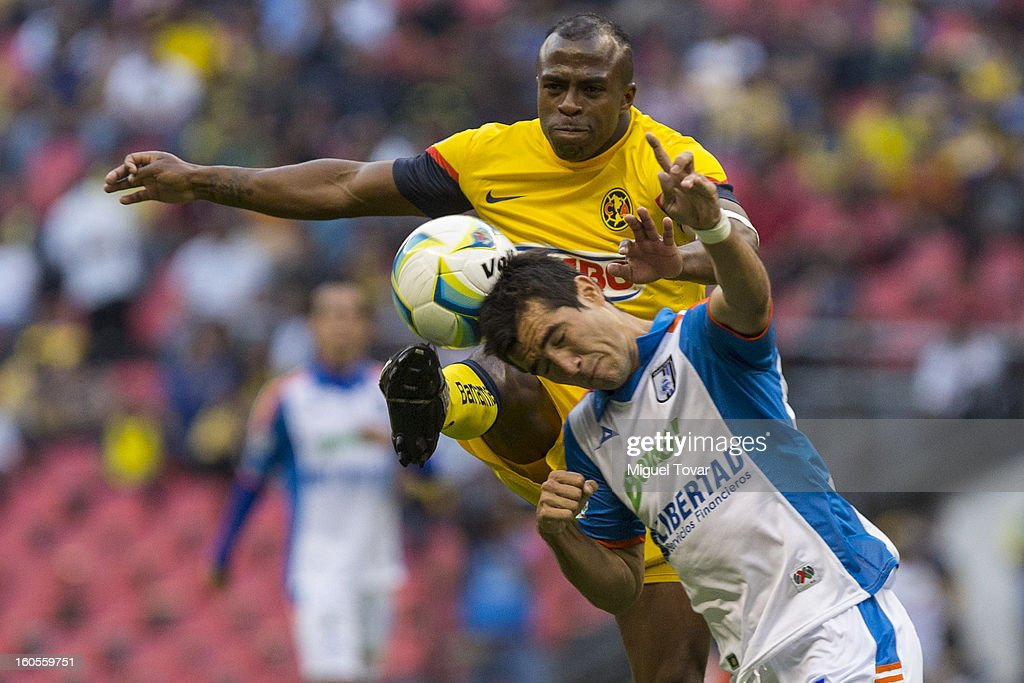 Christian Benitez of America fights for the ball with Mario Osuna of Queretaro during a Clausura 2013 Liga MX match at Azteca Stadium on February 02, 2013 in Mexico City, Mexico.