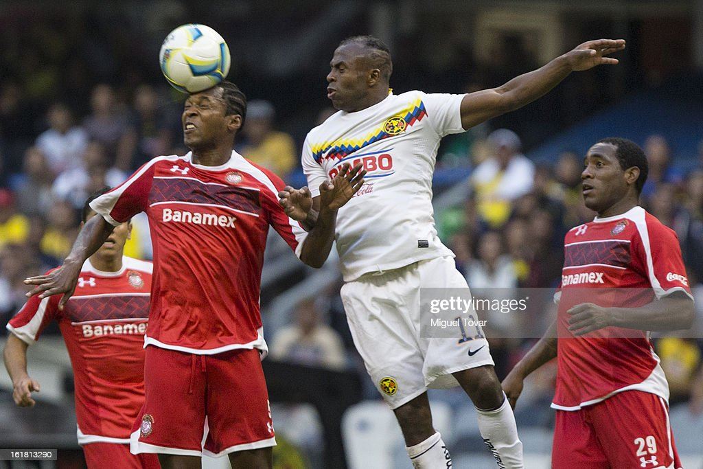 Christian Benitez of America fights for the ball with Wilson Tiago of Toluca during a Clausura 2013 Liga MX match between America and Toluca at Azteca Stadium on February 16, 2013 in Mexico City, Mexico.