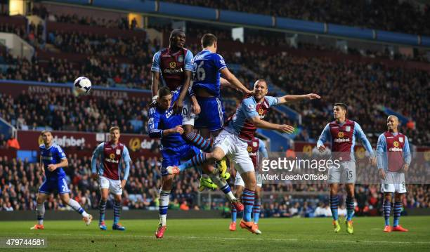 Christian Benteke and Ron Vlaar of Villa battle for a header with Fernando Torres and John Terry of Chelsea during the Barclays Premier League match...