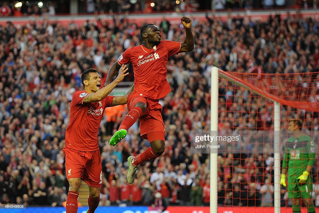 <a gi-track='captionPersonalityLinkClicked' href=/galleries/search?phrase=Christian+Benteke&family=editorial&specificpeople=4282509 ng-click='$event.stopPropagation()'>Christian Benteke</a> celebrates his goal with <a gi-track='captionPersonalityLinkClicked' href=/galleries/search?phrase=Dejan+Lovren&family=editorial&specificpeople=5577379 ng-click='$event.stopPropagation()'>Dejan Lovren</a> of Liverpool during the Barclays Premier League match between Liverpool and A.F.C. Bournemouth on August 17, 2015 in Liverpool, United Kingdom.