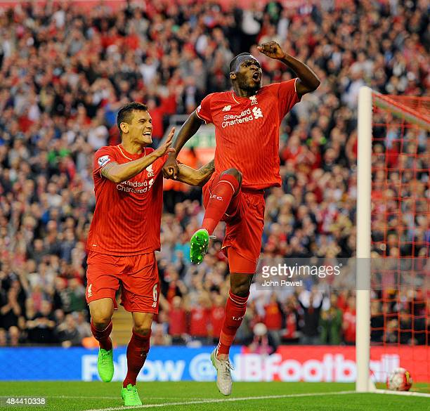 Christian Benteke celebrates his goal with Dejan Lovren of Liverpool during the Barclays Premier League match between Liverpool and AFC Bournemouth...