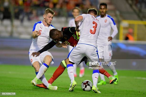 Christian Benteke forward of Belgium is challenged by Tomas Kalas defender of Czech Republic and Jakub Brabec defender of Czech Republic during a...
