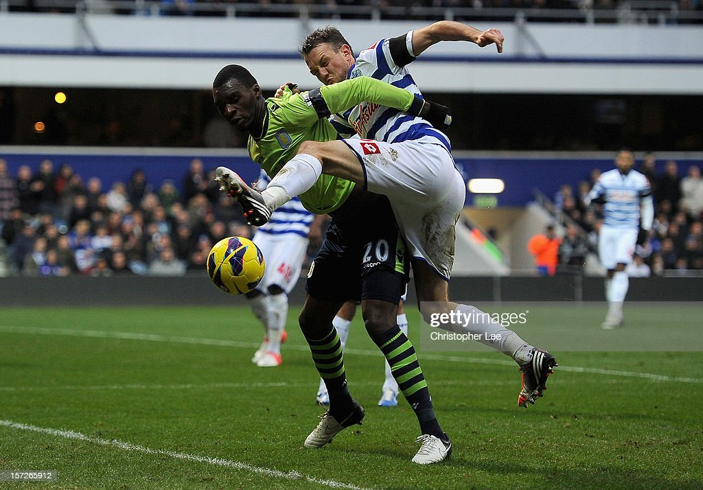 Christian Benteke of Aston Villa and Clint Hill of Queens Park Rangers battle for the ball during the Barclays Premier League match between Queens Park Rangers and Aston Villa at Loftus Road on December 1, 2012 in London, England.