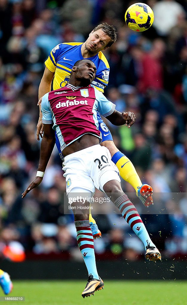 <a gi-track='captionPersonalityLinkClicked' href=/galleries/search?phrase=Christian+Benteke&family=editorial&specificpeople=4282509 ng-click='$event.stopPropagation()'>Christian Benteke</a> #20 of Aston Villa battles in the air with <a gi-track='captionPersonalityLinkClicked' href=/galleries/search?phrase=Phil+Jagielka&family=editorial&specificpeople=682518 ng-click='$event.stopPropagation()'>Phil Jagielka</a> of Everton during the Barclays Premier League match between Aston Villa and Everton at Villa Park on October 26, 2013 in Birmingham, England