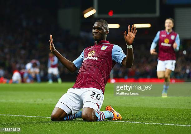 Christian Benteke of Aston Villa celebrates as he scores their second goal during the Barclays Premier League match between Aston Villa and Queens...