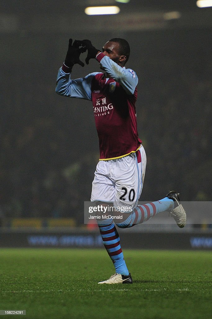Christian Benteke of Aston Villa celebrates his goal during the Capital One Cup Quarter-Final match between Norwich City and Aston Villa at Carrow Road on December 11, 2012 in Norwich, England.